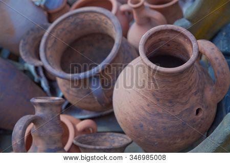 Pottery Craft Ceramic. Clay Dishes .old Ceramic Tableware Is Handmade On The Counter . Handmade Clay