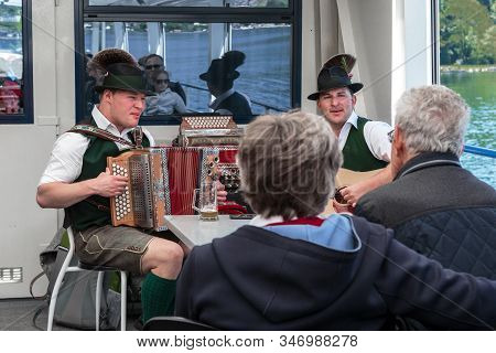 St. Gilen, Austria - May 19, 2019: These Are Unidentified Austrian Folk Musicians Accompanying A Ple