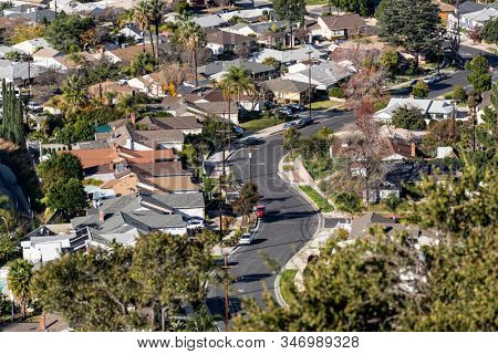 Hilltop view of houses and curvy suburban streets in the northeast San Fernando Valley area of  Los Angeles, California.