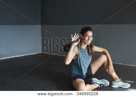 Happy Female Athlete Satisfied Herself After Finish Good Workout Training Session, Sit On Gym Floor,