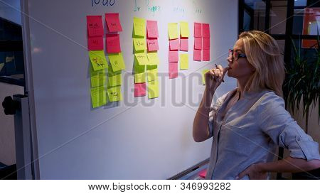 Project Management And Schedule Planning, Concept. A Young Woman Takes Notes And Plans The Structure