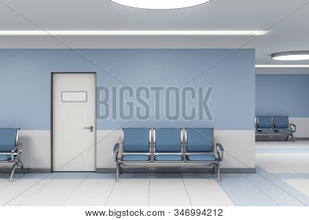 Modern Waiting Room In Blue Medical Office Interior With Chairs And Blank Wall. Medical And Healthca