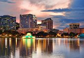 Orlando Lake Eola sunset with urban architecture skyline and colorful cloud poster