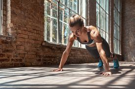 Young Fit Sporty Active Woman Wear Sportswear Standing In Plank Pose Doing Yoga Fitness Training Wor