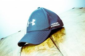Alloa, Scotland - 17 July 2019: Under Armour Hat Isolated On Wooden Background
