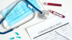 Coronavirus Blood Test Concept. Laboratory Table With Medical Form Coronavirus Test, Respiratory Mas