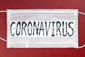 Novel Coronavirus - 2019-ncov, Wuhan Virus Concept. Surgical Mask Protective Mask With Coronavirus T
