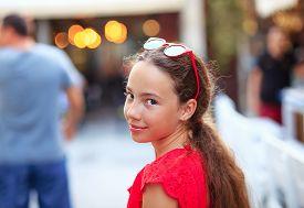 Happy Cute Teen Girl Is Smiling And Having Fun Outdoors At Summer Evening