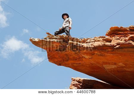 Man Standing On The Rock Edge