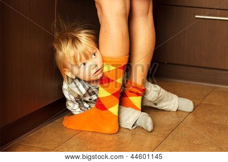 Boy Hiding Behind Mother