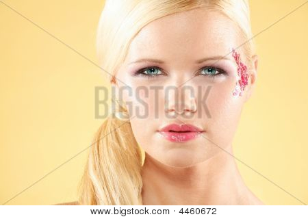 Model With Piercing Blue Eyes Against Yellow Background