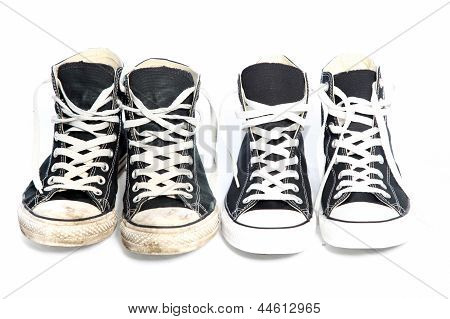Two Pairs Of Sneakers - One Old, One New