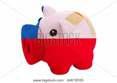 Closed Piggy Rich Bank With Bandage In Colors National Flag Of Chile