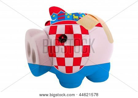 Closed Piggy Rich Bank With Bandage In Colors National Flag Of Croatia