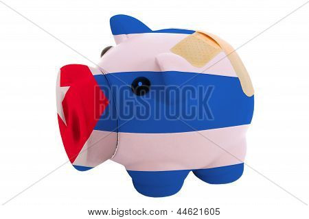 Closed Piggy Rich Bank With Bandage In Colors National Flag Of Cuba