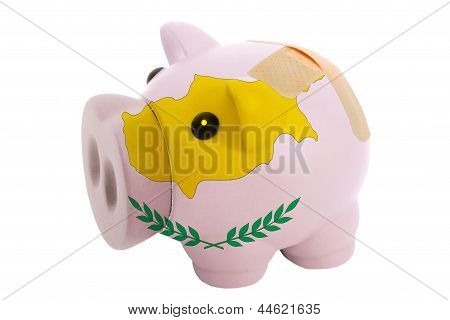 Closed Piggy Rich Bank With Bandage In Colors National Flag Of Cyprus