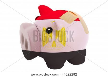 Closed Piggy Rich Bank With Bandage In Colors National Flag Of Egypt