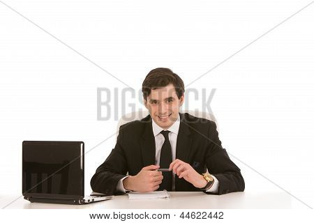 Successful Businessman Seated At His Desk