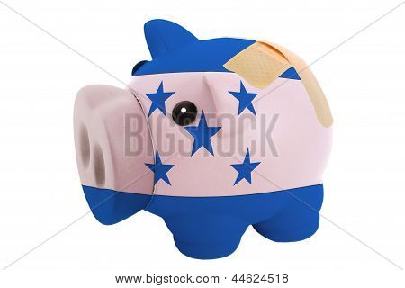 Closed Piggy Rich Bank With Bandage In Colors National Flag Of Honduras