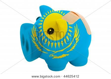Closed Piggy Rich Bank With Bandage In Colors National Flag Of Kazakhstan