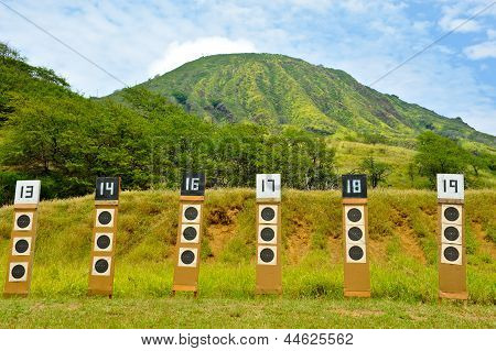 Shooting Range Targets In Line Under A Mountain
