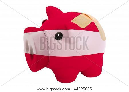 Closed Piggy Rich Bank With Bandage In Colors National Flag Of Latvia