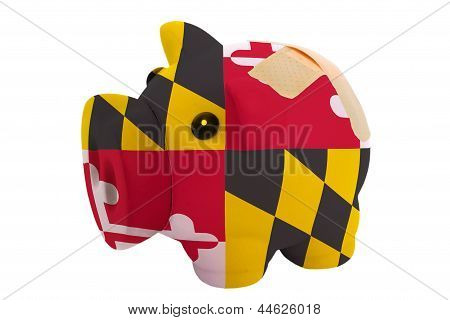 Closed Piggy Rich Bank With Bandage In Colors Flag Of American State Of Maryland