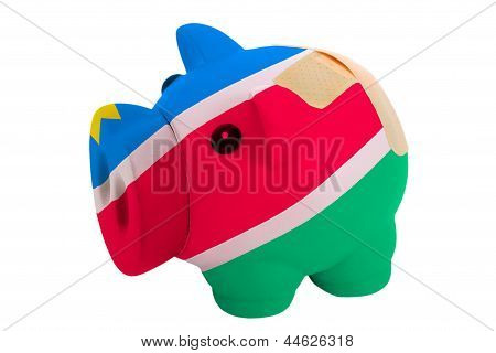 Closed Piggy Rich Bank With Bandage In Colors National Flag Of Namibia