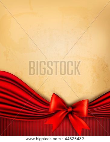 Vintage Background With Old Paper With Red Gift Bow And Red Ribb