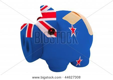 Closed Piggy Rich Bank With Bandage In Colors National Flag Of New Zealand