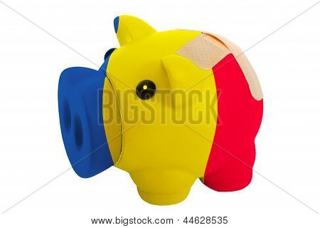 Closed Piggy Rich Bank With Bandage In Colors National Flag Of Romania