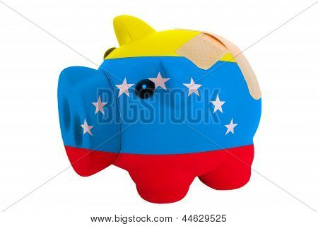 Closed Piggy Rich Bank With Bandage In Colors Flag Of American State Of Vermont
