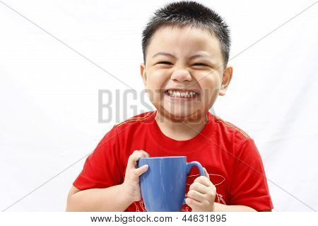 Little Boy Holding and Drinking from Mug