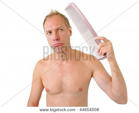 Bewildered Man Hand Holding Comb On The Head