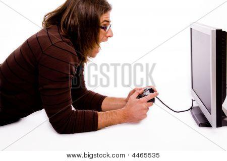 Side Pose Of Shouting Man Playing Videogame