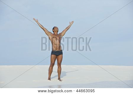 Man standing with his arm outstretched