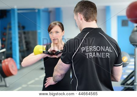 Fitness Instructor With Girl Doing Workout