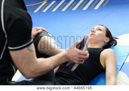 Fitness Instructor Guiding Girl Through Stretching