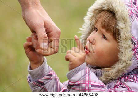 Parent Holds The Hand Of A Little Daughter