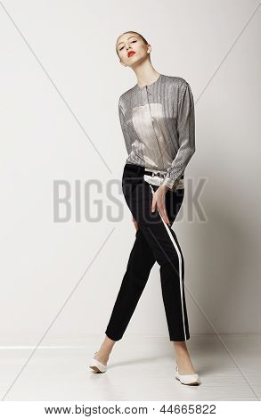 Lifestyle. Sporty Slim Woman In Black Pants - Summer Collection. Glamor