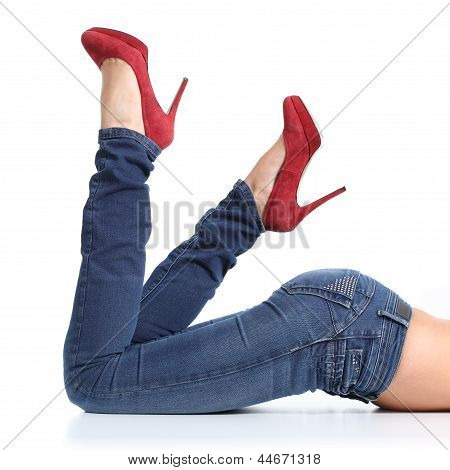 Close Up Of A Beautiful Woman Legs With Blue Jeans And Red Heels