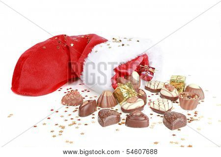 Chocolate and santa hat on a white background