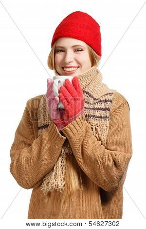 Smiling Woman In Winter Clothing With Cup