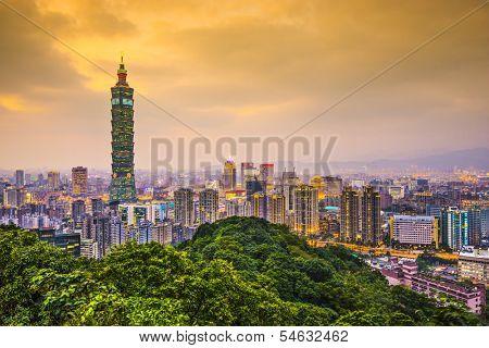 Modern office buildings in Taipei, Taiwan at dusk.