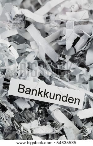 shredded paper tagged with bank customers, symbol photo for destruction of data, customer data, and bank secrecy
