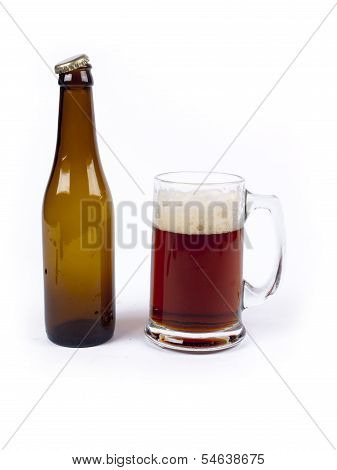Empty Bottle Of Bock Beer Next To A Full Glass