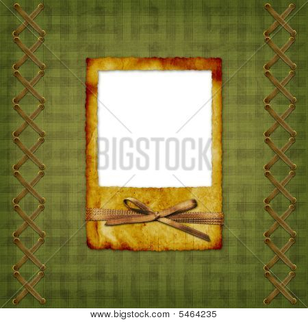 Old Scarred Photoframe On The Abstract Background With Bow