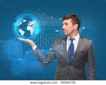 business, new technology and office concept - attractive buisnessman holding virtual sphere globe on the palm of his hand