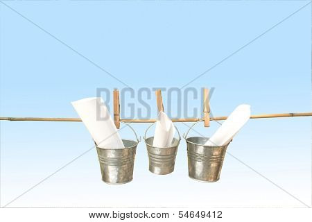 Three Galvanized Buckets Pegged On Bamboo Stick