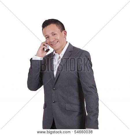 Smiling young businessman talking on cell phone
